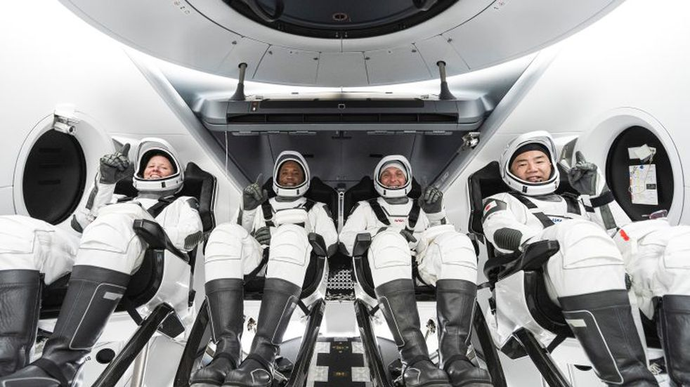 This undated photo made available by SpaceX in September 2020 shows, from left, NASA astronauts Shannon Walker, Victor Glover, commander Mike Hopkins and Japan Aerospace Exploration Agency astronaut Soichi Noguchi inside SpaceX's Crew Dragon spacecraft. The four are scheduled to be SpaceX's second crew launch in mid-November 2020. (SpaceX via AP)
