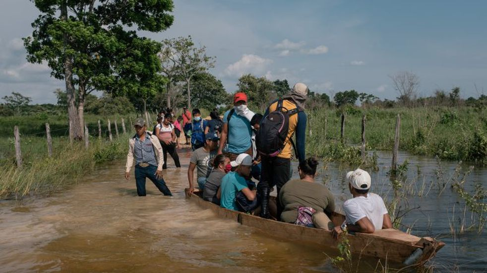 Central American migrants cross a river near the port of entry at El Ceibo in the town of Tenosique, Tabasco state, Mexico, on Sunday, Oct. 4, 2020. Hundreds of U.S.-bound Honduran migrants who had entered Guatemala this week without registering were being bused back to their country's border Saturday by authorities who met them with a large roadblock, the Associated Press reported. Photographer: Luis Antonio Rojas/Bloomberg
