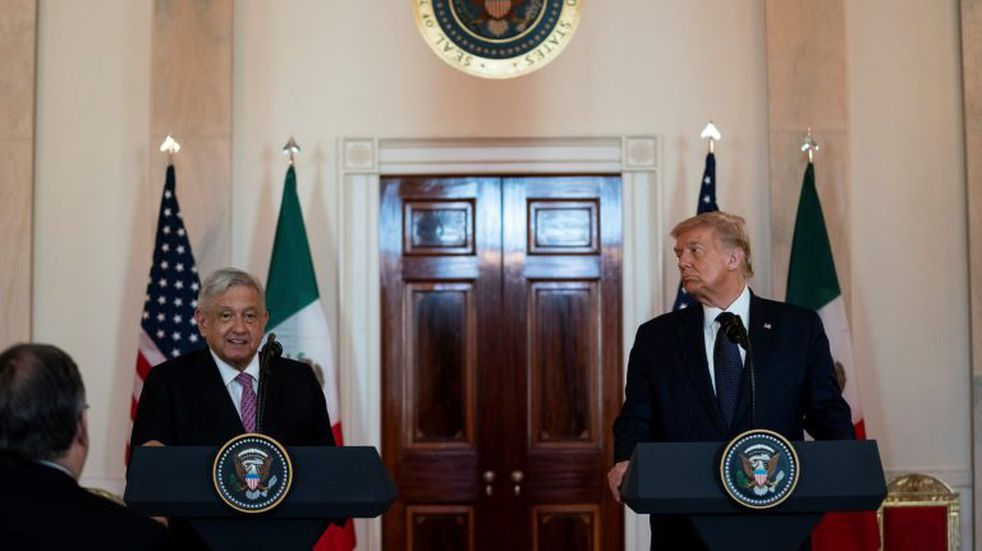 President Donald Trump listens as Mexican President Andres Manuel Lopez Obrador delivers a statement before a dinner at the White House, Wednesday, July 8, 2020, in Washington. (AP Photo/Evan Vucci)