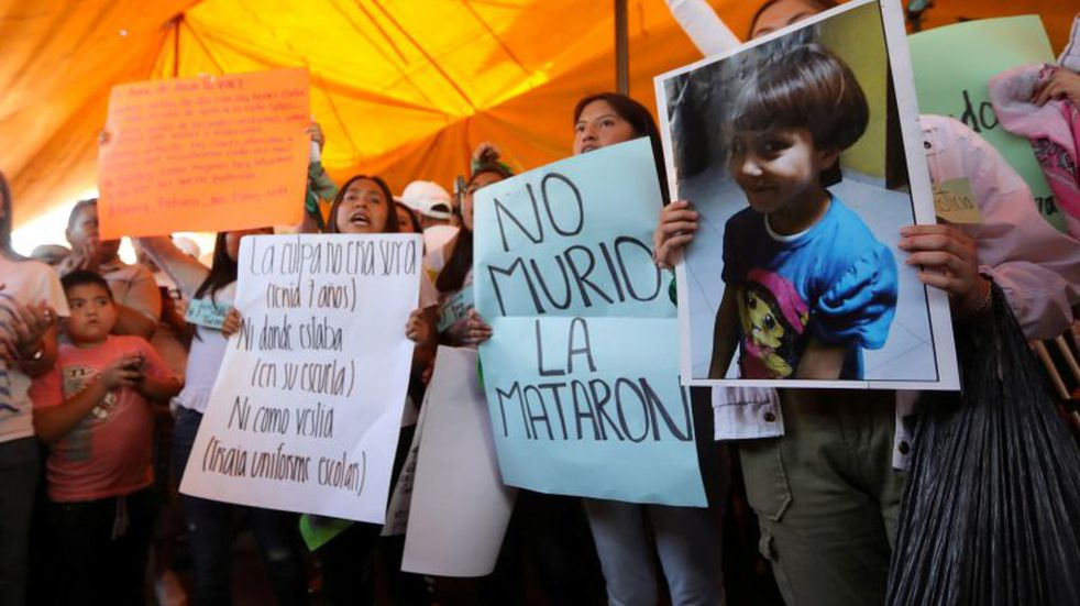 Activists hold placards at the home of Fatima Cecilia Aldrighett, 7, who went missing on February 11 and whose body was discovered over the weekend inside a plastic garbage bag, in Mexico City, Mexico, February 17, 2020. REUTERS/Edgard Garrido
