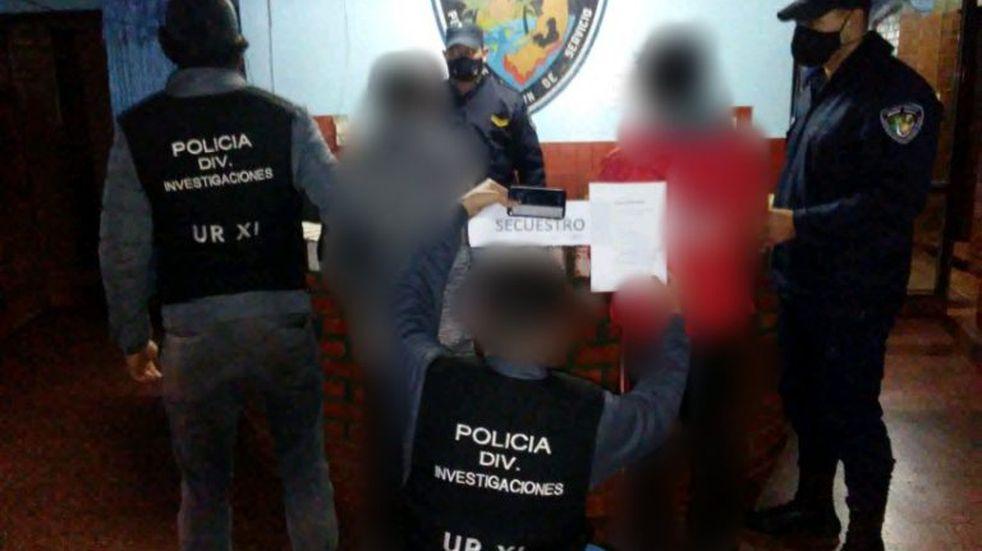 Dos detenidos y un teléfono robado recuperado en un allanamiento