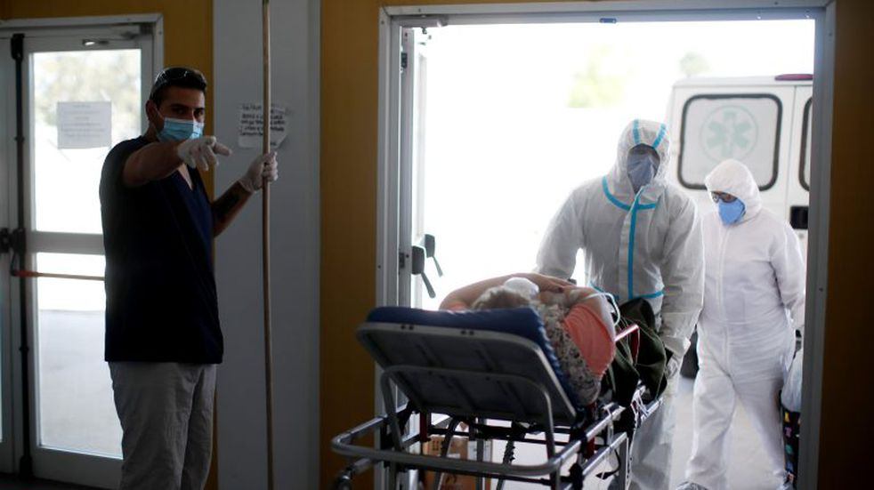 Health workers enter a stretcher with a COVID-19 patient at a hospital in Mar del Plata, Argentina, Saturday, Oct. 10, 2020. (AP Photo/Natacha Pisarenko)