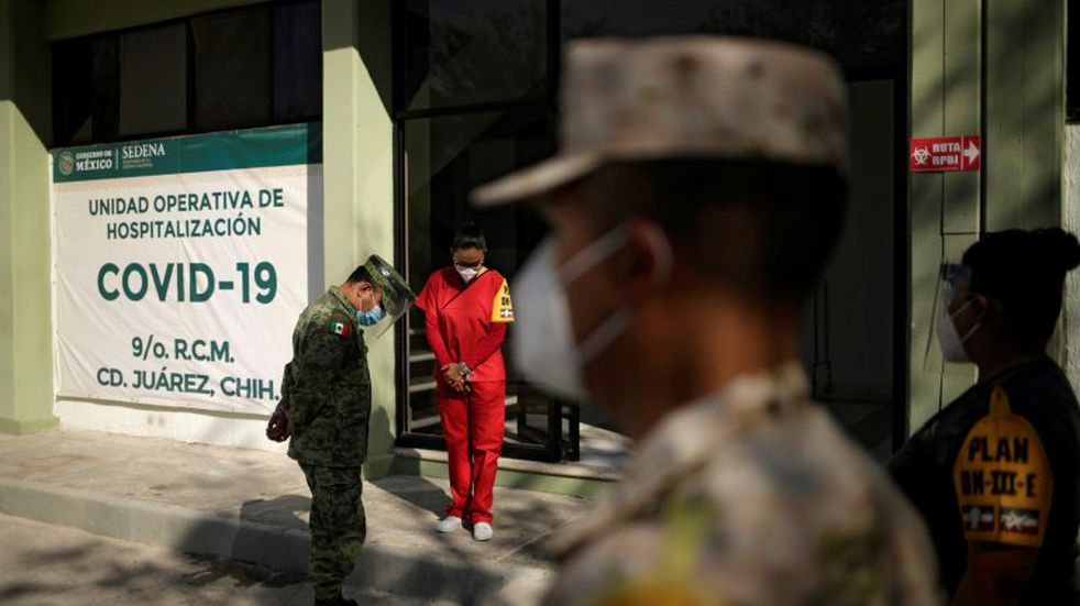 Military and health workers are photographed while a patient who recovered from the coronavirus disease (COVID-19) is discharged from the military hospital in Ciudad Juarez, Mexico October 7, 2020. REUTERS/Jose Luis Gonzalez