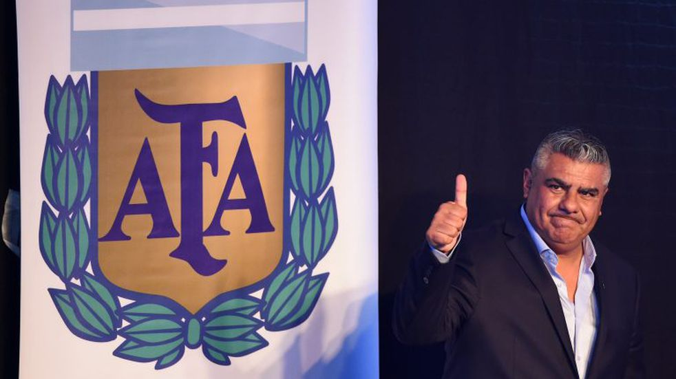 (FILES) In this file picture taken on March 29, 2017 the president of Argentine football team Barracas Central, Claudio Tapia, gives the thump up after being elected President of Argentina's Football Association (AFA) in Ezeiza, Buenos Aires. - The Argentine football association will put an end to the 2019-20 season which has been interrupted since mid-March due to the coronavirus pandemic, its president Claudio Tapia said on April 27, 2020. Argentina has been in lockdown since March 20, with the quarantine restrictions in place until at least May 10. (Photo by Eitan ABRAMOVICH / AFP)